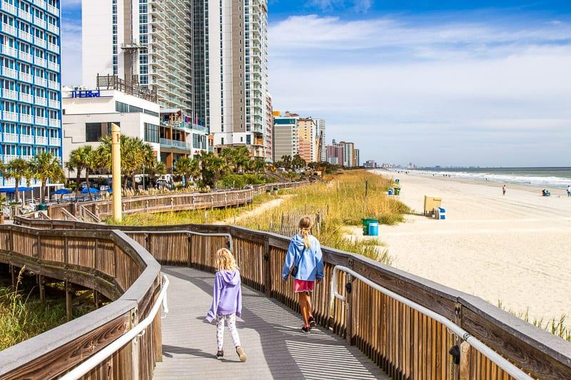 Our kids walking the Myrtle Beach Boardwalk